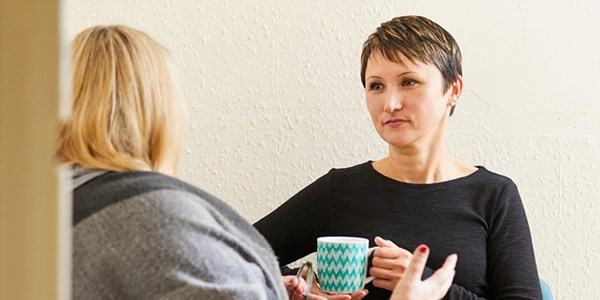 A service user speaks to a staff member at a Domestic Abuse charity