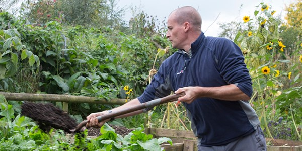 Service user at a mental health charity doing some gardening